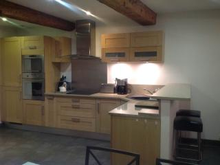 Light Oak kitchen with Granite worktops, eye level oven and microwave, induction hob and dishwasher.