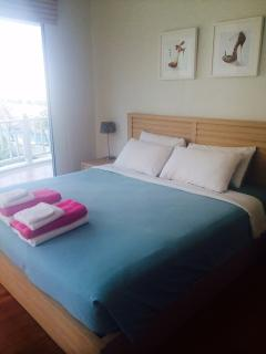 Bedroom 1 - Kingsize Bed with ensuite - bath, shower & toilet & Balcony
