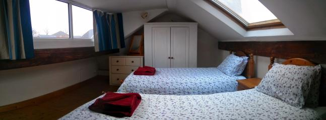 Bedroom #3. Two single beds. Views towards York Minster.
