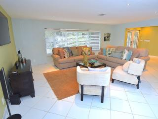 Spacious (Bright) Open Living Area Offers Two Full Size Sofas + Two Chairs + 60 Inch LED High Def TV