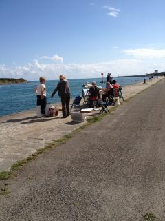 Local Art Classes on harbour wall.