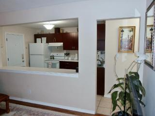 Suite 1. Elegant Front Entrance into Suite with Kitchen with Breakfast Bar.