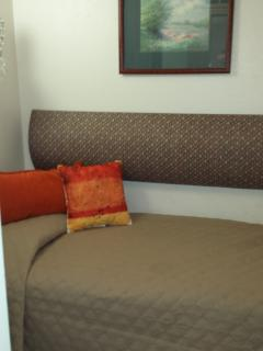 Sleeping alcove with a twin bed. Cozy area with curtains that can be drawn for privacy