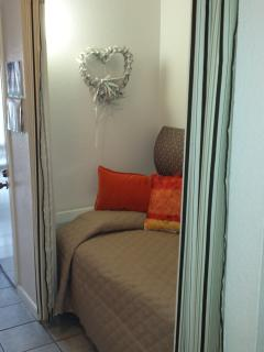 Sleeping alcove for a child or adult. New comforter and colorful pillows. Nice space!