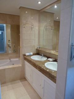 En-suite with large walk-in shower, twin wash basins and bath