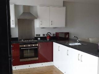 Leading on from dining - stunning fully fitted kitchen,all cooking utensils,2nd set patio doors