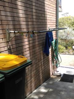 Outside beside the unit has clothes line and a hose for washing a car or rinsing that surfboard