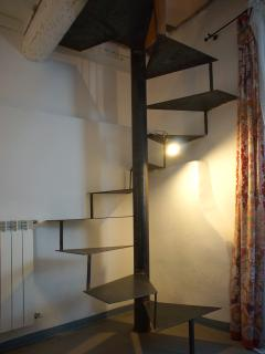 Spiral staircase from the bedroom to the living room