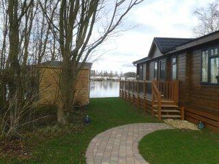 Luxury Lakeside Lodge with summerhouse and private hot tub.