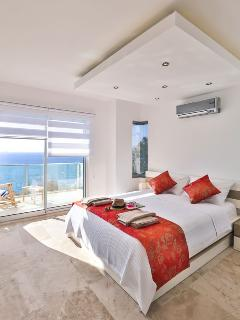 Master bedroom with private balcony.