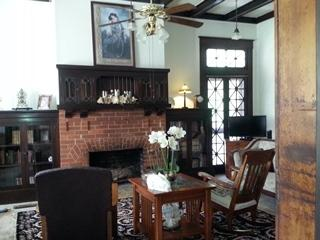 Formal living room offers fireplace, flatscreen tv, blueray/DVD player
