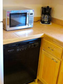 The kitchen features a dishwasher and microwave.