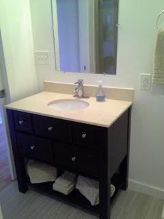 Sink and vanity in 1st floor bathroom