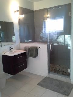 3rd floor master bathroom features large glass-enclosed shower with Zen pebble floor & bench seat