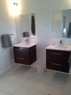 3rd floor master bathroom features two separate sinks and vanities (and private toilet room)