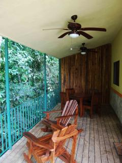 Extended covered deck that backs to the jungle for your enjoyment