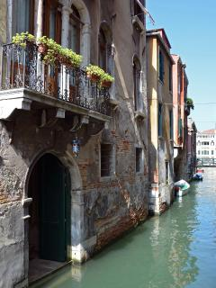the Ca Pesaro Suite is located next to a charming canal