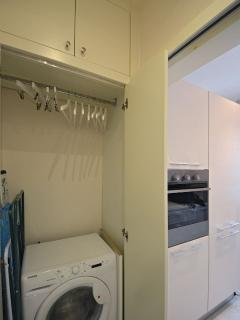 next to the kitchen can be found a closet for coats and washing machine