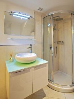 bathroom with shower and washer at the ground floor