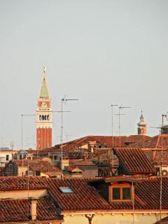 the view from the attic bedroom on the roof-tops of the historical center