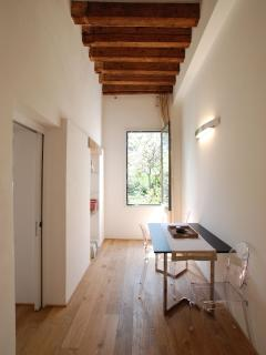 tall wooden beamed ceilings and brushed parquet flooring