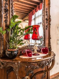 the house showcases prestigious murano glass objects and authentic antique furniture