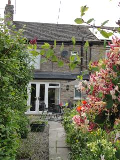 The cottage has its own sunny patio and garden with long views to Nappa Scar