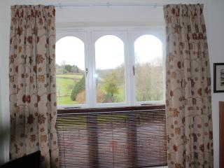2 large windows with views up through the paddock and to the Black Mountains.