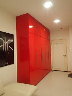 Red wardrobe, large enough to store your personal belongings. Fitted with shoe cabinet too!