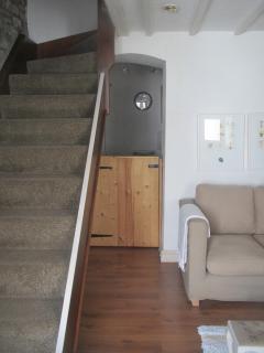 Living room, stairway to bedrooms & bathroom.
