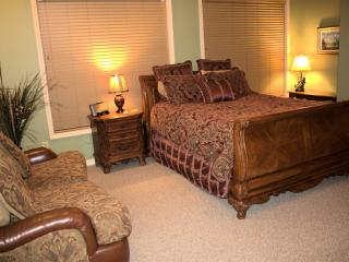 Loveseat in bedroom area.