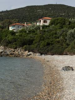 Small beach of Glyfa bay and the villa at the top