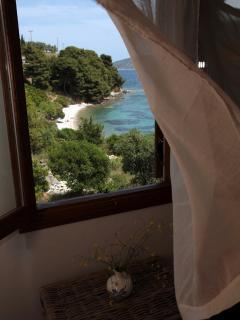 View from the double bedroom window overlooking the small beach of Glyfa bay