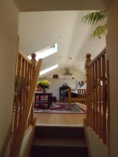 View from staircase up into upstairs Living area