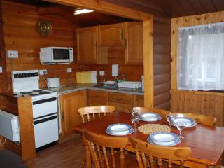Fully equipped kitchen and dinning area, seats six. With views over the Rhinog Mountains.