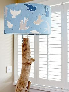 Tasteful and coordinated interior design features - handmade driftwood lamp