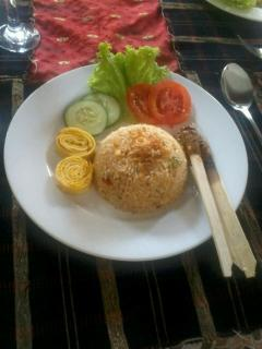 Nasi Goreng Bali, tasty Bali traditional culinary with satay as breakfast (on choice)