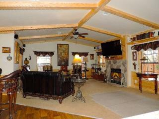The Great Room has a lovely wood burning fireplace, dozens of antiques, art & hundreds of books