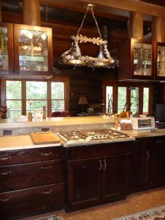 Kitchen is equipped for easy cooking for one or many guests.