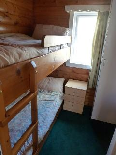 Two bunk bedrooms, sleep adults and children alike, four in total, with heating & storage.