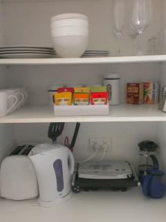 Toaster, kettle, sandwich maker, plunger coffee, herbal teas, cereals (& tim tams in the fridge!)
