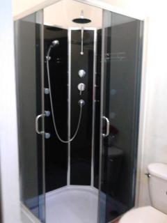 Lovely shower room with jets and shower massage