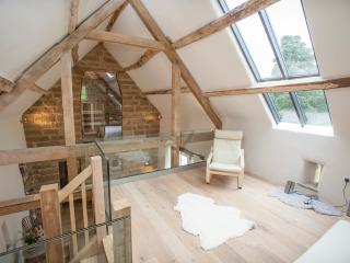 Imagine yourself relaxing on the gallery in this National Design Award winning barn conversion