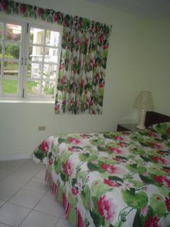 Bedroom with King bed. Beautiful decorated with Caribbean garden style fabric