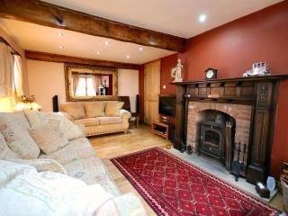 Lounge with Cosy Log Burner Set in Antique Fire Surround for those Romantic Nights in