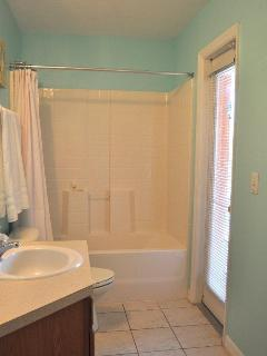 Bathroom off the pool near twin bedrooms
