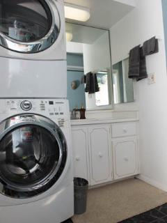 Master bath with washer and dryer
