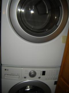 modern washer/dryer in upstairs hall closet