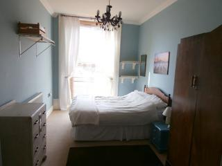 Spacious double bedroom, ample storage, bedside tables & reading lamps.
