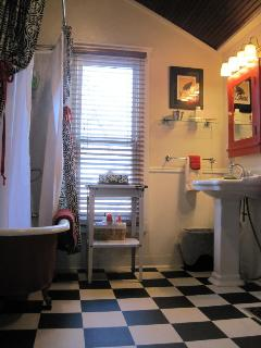 Bath with claw-foot tub & shower is spacious and airy